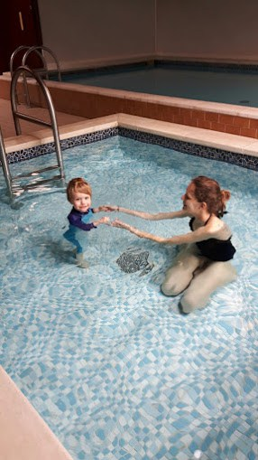 Mummy and toddler swimming