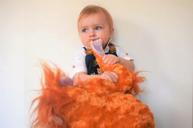 mischievous toddler wearing disney store
