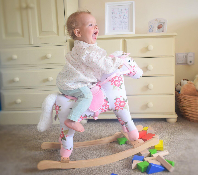 baby on rocking horse