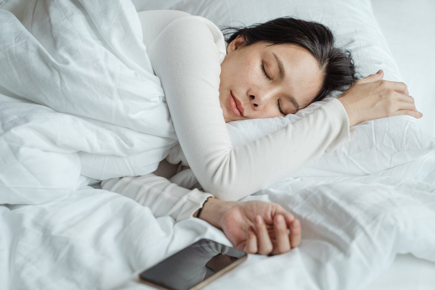 woman sleeping in bed poor mental health