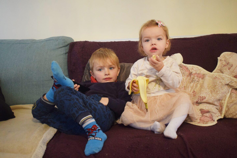 kids-sat-on-sofa-watching-screen-time